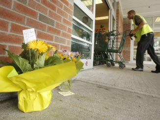 SACO, ME - AUGUST 20: People have placed flowers outside of the entrance to Shaw's supermarket in Saco on Thursday morning. Wendy Boudreau, 59, died after being stabbed  inside the supermarket on Wednesday and police have charged Connor MacCalister, 31, with her murder. (Photo by Gregory Rec/Staff Photographer)
