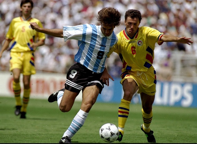3 Jul 1994:  Gabriel Batistuta of Argentina takes on Gheorghe Popescu of Romania during the World Cup second round match at the Pasadena Rose Bowl in Los Angeles. Romania won 3-2.  Mandatory Credit: David Cannon /Allsport