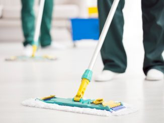 Close-up,Of,Person,Holding,A,Floor,Mop,While,Cleaning,A